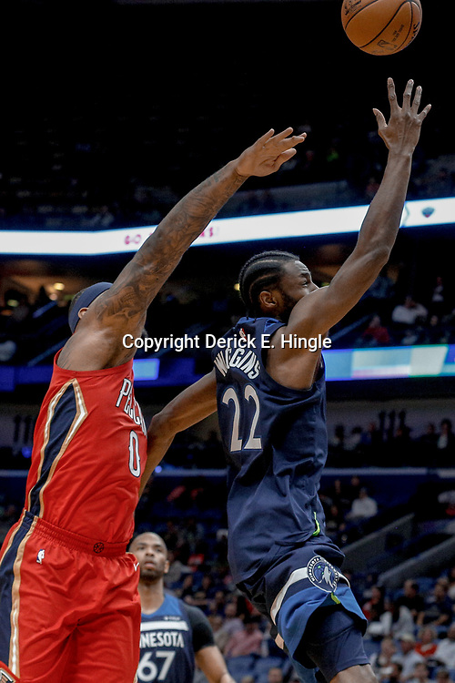 Nov 29, 2017; New Orleans, LA, USA; Minnesota Timberwolves forward Andrew Wiggins (22) shoots over New Orleans Pelicans center DeMarcus Cousins (0) during the first quarter of a game at the Smoothie King Center. Mandatory Credit: Derick E. Hingle-USA TODAY Sports