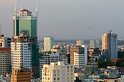 Downtown Saigon. Airplane landing in Tan Son Nuth Airport.