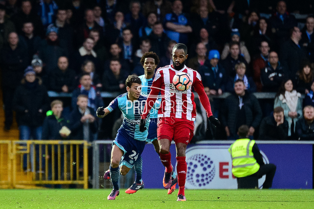 Stourbridge FC striker Kayleden Brown (10) controls under pressure from Wycombe Wanderers midfielder Scott Kashket (24) during the The FA Cup match between Wycombe Wanderers and Stourbridge at Adams Park, High Wycombe, England on 7 January 2017. Photo by Dennis Goodwin.