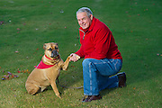 Former Razorback head coach Ken Hatfield with his dog Margo on Friday, November 8, 2013, in Fayetteville, Ark.<br /> <br /> Photo by Beth Hall