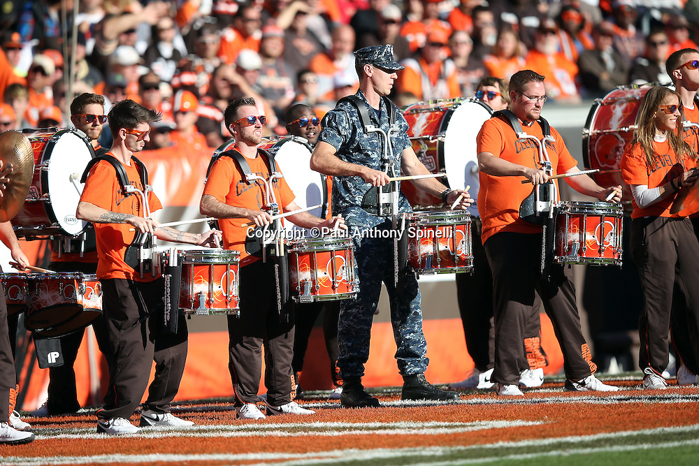 The Cleveland Browns drum line is joined by a member of the United States Army during the 2015 week 8 regular season NFL football game against the Arizona Cardinals on Sunday, Nov. 1, 2015 in Cleveland. The Cardinals won the game 34-20. (©Paul Anthony Spinelli)