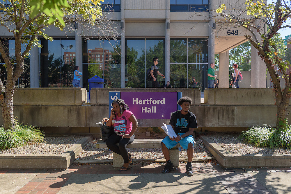 Katrice Gill, left, a communications major/ social justice minor, shares a bench with student Jason Dunlap outside Hartford Hall on First Street on the Jefferson Community & Technical College downtown campus Thursday, Sept. 22, 2016 in Louisville, Ky. (Photo by Brian Bohannon)