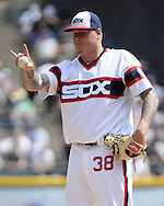 CHICAGO - APRIL 24:  Mat Latos #38 of the Chicago White Sox requests that he throw two additional warm up pitches during the game against the Texas Rangers on April 24, 2016 at U.S. Cellular Field in Chicago, Illinois.  The White Sox defeated the Rangers 4-1.  (Photo by Ron Vesely)   Subject: Mat Latos