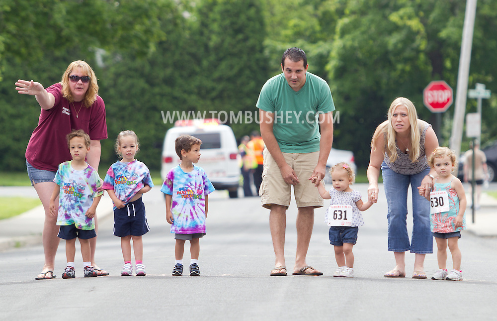 Middletown, New York - Parents stand by children on the starting line of the kids dash at the 16th annual Ruthie Dino-Marshall 5K Run/Walk put on by the Middletown YMCA on Sunday, June 10, 2012.