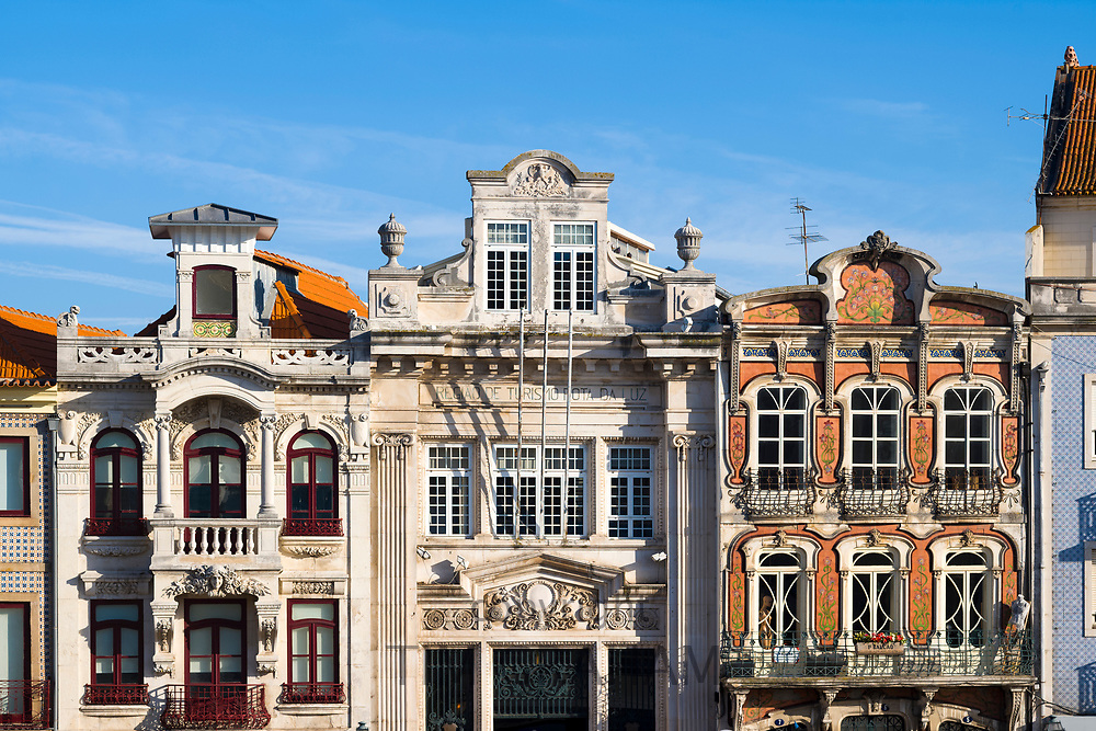 Elegant Portugese architecture of ornate buildings canalside by the Canal Central in Aveiro,  Portugal