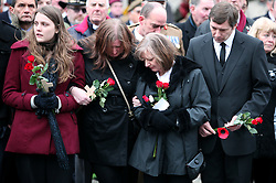 © under license to London News Pictures.  25/11/10..(Left to right, confirmed by a visiting army officer) The girlfriend, sister, mum and stepfather of Guardsman Christopher Davies the 100th soldier to die in Afghanistan, await his body in Wootton Bassett. Guardsman Davies of 1st Battalion Irish Guards was killed while taking part in a security patrol in Nahr-e Saraj (North), Helmand province on November 17. ..Picture credit should read: Rebecca Mckevitt/London News Pictures