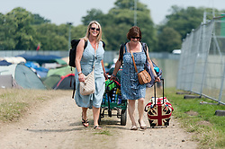 © Licensed to London News Pictures. 18/07/2014. Southwold, UK.   Festival goers arrive at the campsite at  Latitude Festival 2014 Day 1 on a hot sunny morning. Today is expected to be the hottest day of the year with temperatures forecast to reach 32 degrees centigrade.   Latitude is an British annual music festival.  Photo credit : Richard Isaac/LNP