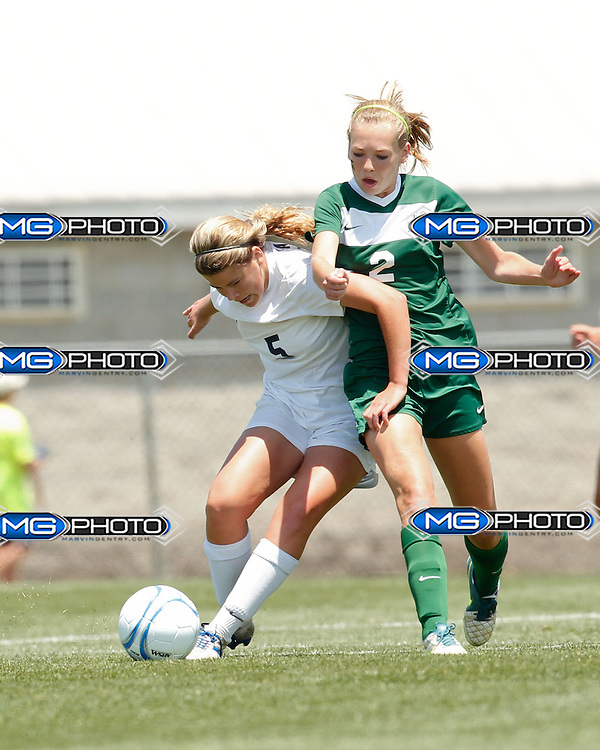 May 10, 2014; Huntsville, AL, USA;  Oak Mountain Alexandra Glenn Dunn (5) controls the ball from Mountain Brook Emma Thompson (2)  during the 6A State Soccer Championship at John Hunt Soccer Complex. Mandatory Credit: Marvin Gentry