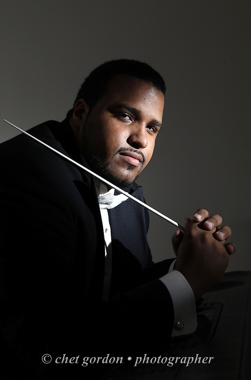 Maestro Marcus Parris in his apartment in the City of Newburgh, NY on Wednesday, July 22, 2009. Parris will lead the Greater Newburgh Symphony Orchestra during a performance at Downing Park in Newburgh on July 25.  © CHET GORDON/Times Herald-Record