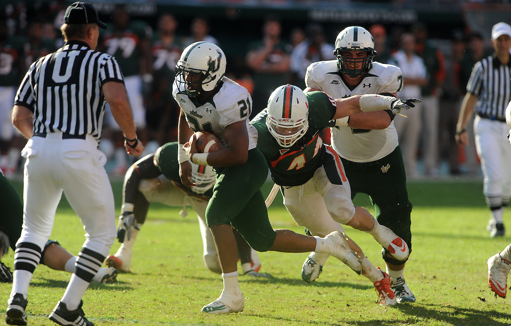 MIAMI GARDENS, FL - NOVEMBER 27: Demetris Murray #21 of the South Florida Bulls in action during the game against the Miami Hurricanes at Sun Life Stadium in Miami Gardens, Florida on November 27, 2010. South Florida defeated the Hurricanes 23-20.