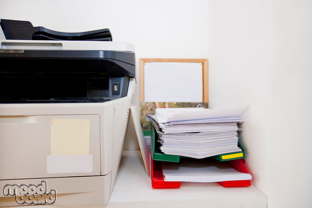 Close-up of printer and paperwork in real life office