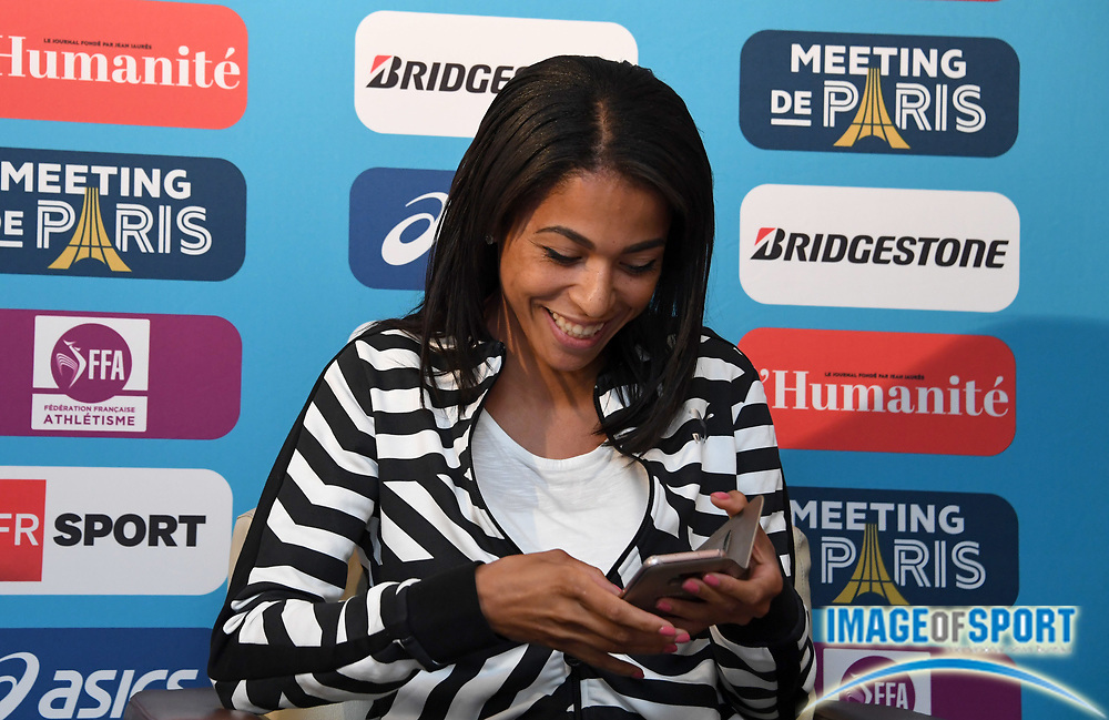Floria Guei (FRA)<br />  holds a cell phone prior to the Meeting de Paris in a IAAF Diamond League press conference at the Mercure Paris Centre Tour Eiffel in Paris on Friday, June 30, 2017.