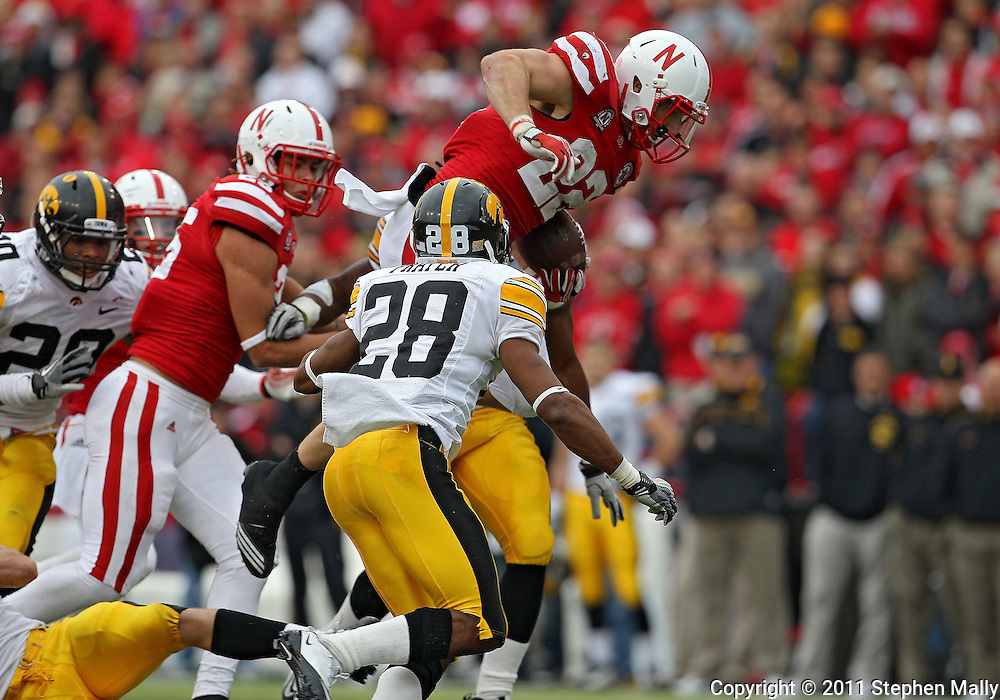 November 25, 2011: Nebraska Cornhuskers running back Rex Burkhead (22) jumps over a defender on a run during the second half of the NCAA football game between the Iowa Hawkeyes and the Nebraska Cornhuskers at Memorial Stadium in Lincoln, Nebraska on Friday, November 25, 2011. Nebraska defeated Iowa 20-7.
