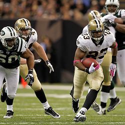 2009 October 04: New Orleans Saints running back Pierre Thomas (23) runs as New York Jets linebacker Vernon Gholston (50) pursues the play during a 24-10 win by the New Orleans Saints over the New York Jets at the Louisiana Superdome in New Orleans, Louisiana.
