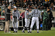 Oct 24, 2009; East Lansing, MI, USA; Michigan State Spartans head coach Mark Dantonio (left) argues with the officiating staff after his team was charged with a personal foul during the fourth quarter against Iowa Hawkeyes at Spartan Stadium. The Hawkeyes beat the Spartans 15-13. Mandatory Credit: Jason Miller-US PRESSWIRE