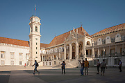 Visitors cross Patio das Escolas to admire the bell tower and Via Latina of Coimbra University, one of the oldest and illustrious universities and places of learning in the world, on 17th July, at Coimbra, Portugal. King Dinis founded a university in 1290 and transferred it to Coimbra in 1537 where theology, medicine and law were mostly studied. It is now a UNESCO World Heritage Site. (Photo by Richard Baker / In Pictures via Getty Images)