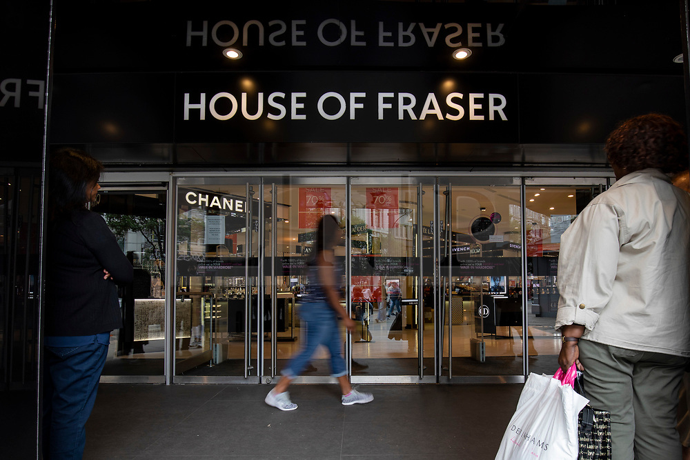 © Licensed to London News Pictures. 10/08/2018. London, UK. Shoppers wait outside House of Fraser's flagship store on Oxford Street in London. The department store chain has reportedly been bought by Sports Direct for £90m after administrators were appointed. Photo credit: Rob Pinney/LNP