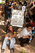 "22 OCTOBER 2011 - PHOENIX, AZ:    Occupy Phoenix protesters during the General Assembly at Occupy Phoenix Saturday. The demonstrations at Occupy Phoenix, AZ, entered their second week Saturday. About 50 people are staying in Cesar Chavez Plaza, in the heart of downtown. The crowd grows in the evening and on weekends. Protesters have coordinated their actions with police and have gotten permission from the city to set up shade shelters and sleep in the park, but without tents or sleeping bags, which is considered ""urban camping,"" instead protesters are sleeping on the sidewalk.      PHOTO BY JACK KURTZ"