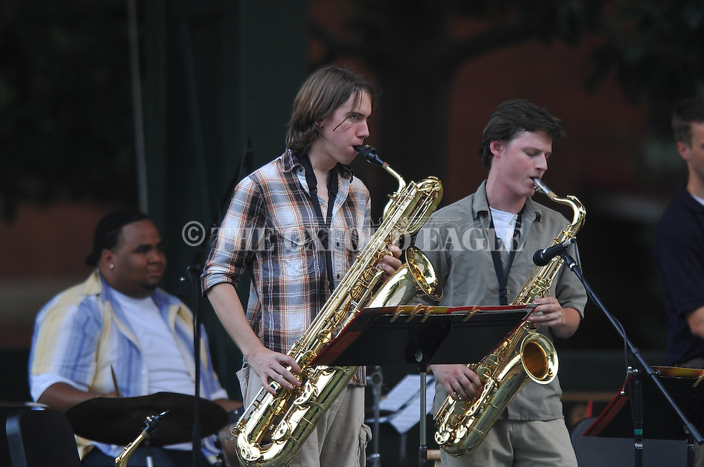 Charlie Young (left) and Jesse Martin play saxaphone as Michael Worthy and Friends perform at the Summer Sunset Series in the Grove at Ole Miss in Oxford, Miss. on Sunday, June 5, 2011.