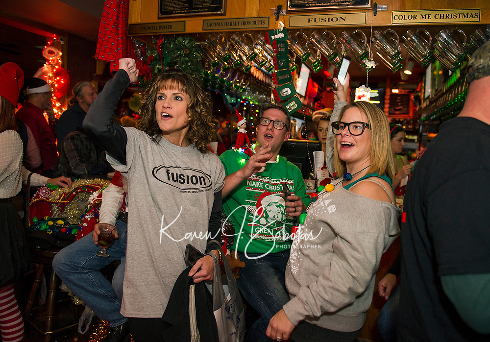 The Fusion Team of Rhonda Reed, Kevin and Shannon Buttermore get recognized for Kevin and his elf's dance moves during the early evening hours of Pub Mania at Patrick's Pub and Eatery.  (Karen Bobotas/for the Laconia Daily Sun)