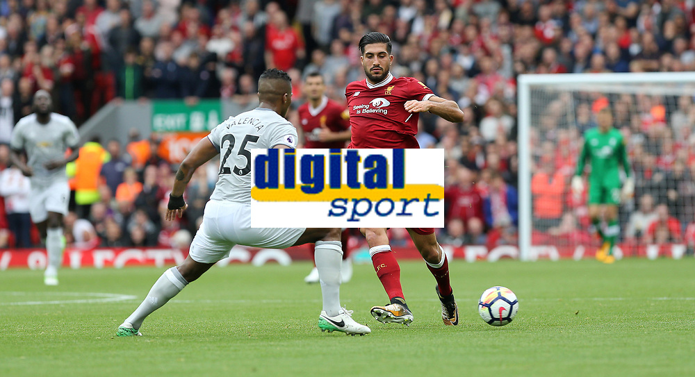 Football - 2017 / 2018 Premier League - Liverpool vs. Manchester United<br /> <br /> Antonio Valencia of Manchester United and Emre Can of Liverpool at Anfield.<br /> <br /> COLORSPORT