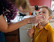 Laura Costik wipes her son Evan's face after dinner in Livonia, N.Y. on August 27, 2014.<br /> <br /> Evan, 6, has type 1 diabetes, and his father, John, modified a continuous glucose monitor and an Android smartphone to provide constant updates on Evan's blood sugar remotely. CREDIT: Mike Bradley for the Wall Street Journal<br /> MEDIHACK