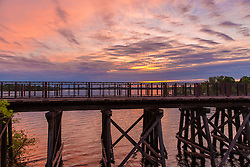 Another Landscape View Of The Arcola Bridge Over Lake Minnetonka, Minnesota at Sunset Withe pink and purple skies