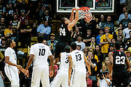 November 24th, 2013:  Harvard Crimson junior forward Jonah Travis (24) dunks the ball in the second half of action in the NCAA Basketball game between the Harvard Crimson and the University of Colorado Buffaloes at the Coors Events Center in Boulder, Colorado