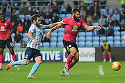 Coventry City midfielder Romain Vincelot puts pressure on Peterborough United midfielder Michael Bostwick during the Sky Bet League 1 match between Coventry City and Peterborough United at the Ricoh Arena, Coventry, England on 31 October 2015. Photo by Alan Franklin.