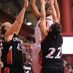 Feb 24, 2009; Piscataway, NJ, USA; Rutgers center Rashidat Junaid (43) takes a shot over the attempted blocks of Cincinnati forward Jill Stephens (45) and forward Shelly Bellman (22) during the second half of Rutgers' 71-52 victory over Cincinnati at the Louis Brown Athletic Center.