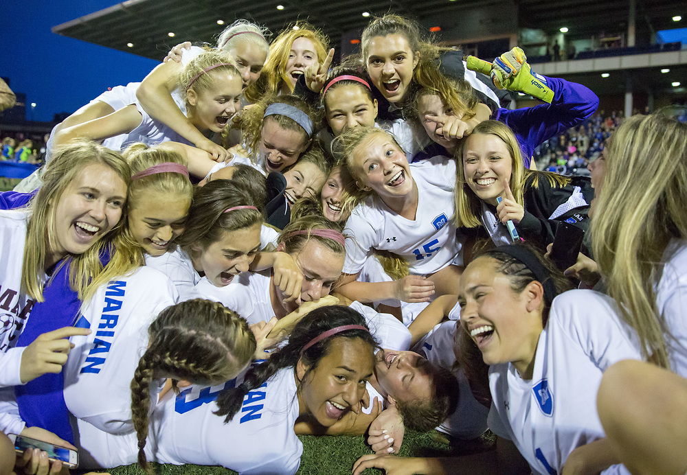 The Omaha Marian Crusaders celebrate their win over Millard North. Millard North played Omaha Marian in the Class A girls Nebraska state soccer championship at Morrison Stadium on Wednesday, May 17, 2017, in Omaha.<br /> <br /> MATT DIXON/THE WORLD-HERALD