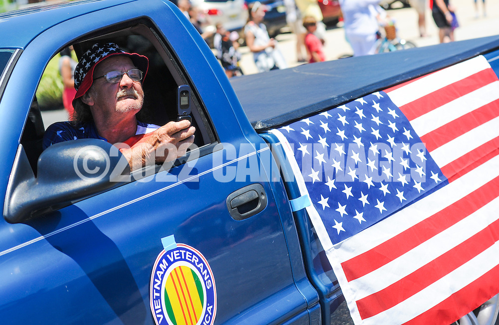 A man makes a picture of the crowd during the Independence Parade Saturday July 2, 2016 on Beach Avenue in Cape May, New Jersey. Photo by William Thomas Cain/Cain Images