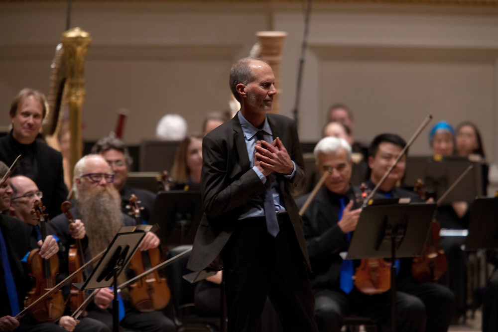 John Luther Adams reacts to a standing ovation after Music Director Ludovic Morlot led the Seattle Symphony Orchestra performing the 2014 Pulitzer prize winning piece, Become Ocean, in the New York premiere during Spring for Music at Carnegie Hall in New York, NY on May 06, 2014.