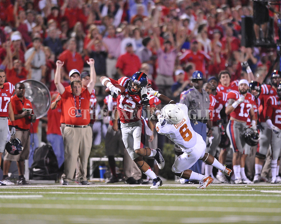 Ole Miss wide receiver Donte Moncrief (12) makes a catch over Texas' Quandre Diggs (6) at Vaught-Hemingway Stadium in Oxford, Miss. on Saturday, September 15, 2012. Texas won 66-21. Ole Miss falls to 2-1.