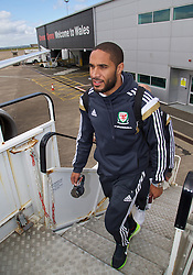 CARDIFF, WALES - Thursday, March 26, 2015: Wales' captain Ashley Williams boards the flight at Cardiff Airport as the squad prepare to fly to Tel Aviv ahead of the UEFA Euro 2016 qualifying Group B match against Israel. (Pic by David Rawcliffe/Propaganda)