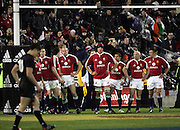The Lions watch on as Dan Carter kicks for goal during the 1st test match between the New Zealand All Blacks and the British and Irish Lions at Jade Stadium in Christchurch,New Zealand on Saturday 25 June, 2005. The All Blacks won 21-3.Photo:Andrew Cornaga/PHOTOSPORT<br />