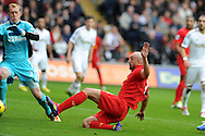 Liverpool's Jose Enrique scores past Swans keeper Gerhard Tremmel but the 'goal' is disallowed. Barclays Premier league, Swansea city v Liverpool at the Liberty Stadium in Swansea , South Wales on Sunday 25th November 2012. pic by Andrew Orchard, Andrew Orchard sports photography,
