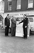 27/09/1962<br /> 09/27/1962<br /> 27 September 1962<br /> Presentation to Mr Michael Young of Churchtown of a refrigerator.<br /> Mr Michael Young received the prize at his Grocery shop in Churchtown, as the winner of a Beechams Quash Display competition. Picture shows Mr Young receiving his prize from Beechams representatives outside his shop. Note the Quash van.