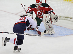 Mar 18; Newark, NJ, USA; New Jersey Devils goalie Martin Brodeur (30) makes a save on a shot by Washington Capitals center Marcus Johansson (90) during the first period at the Prudential Center.
