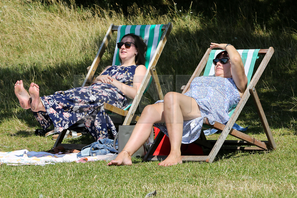 © Licensed to London News Pictures. 22/08/2019. London, UK. Emily and Karen (L to R) enjoys the warm and sunny weather in London's Hyde Park. According to the Met Office, the temperatures are forecast to increase to 30 degrees celsius over the bank holiday weekend. <br /> <br /> ***Permission Granted***<br /> <br /> Photo credit: Dinendra Haria/LNP