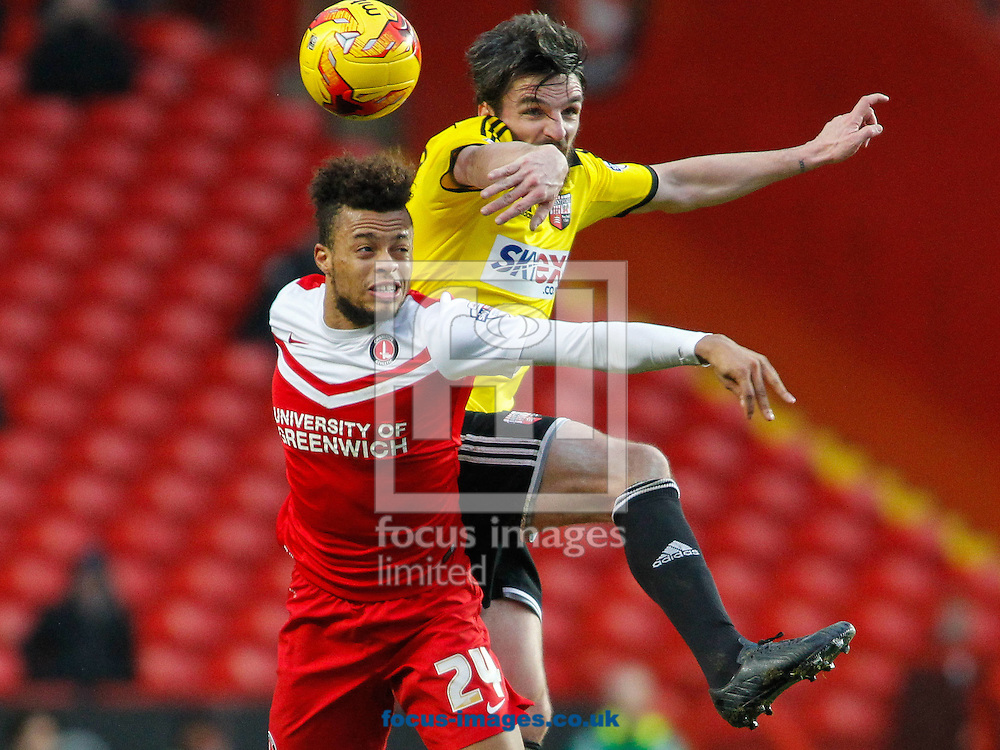 Jonathan Douglas of Brentford Jordan Cousins of Charlton Athletic during the Sky Bet Championship match between Charlton Athletic and Brentford at The Valley, London<br /> Picture by Mark D Fuller/Focus Images Ltd +44 7774 216216<br /> 14/02/2015