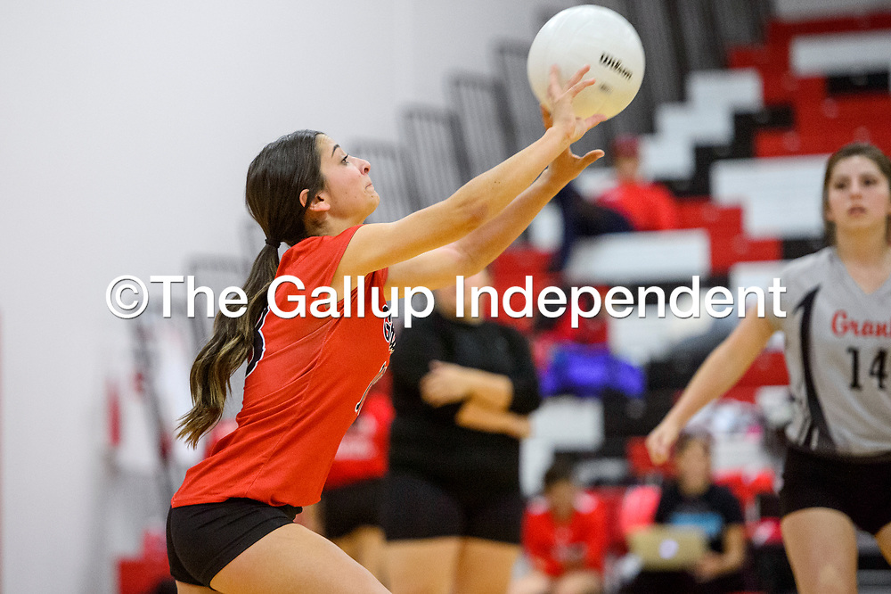Grants Pirate Jadee Merayo (18) tips the ball over to the Valencia Jaguars Tuesday at Grants High School.