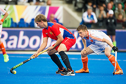 Russia's Aleksandr Cherenkov is watched by Hidde Turkstra of the Netherlands. Russia v The Netherlands - Unibet EuroHockey Championships, Lee Valley Hockey & Tennis Centre, London, UK on 25 August 2015. Photo: Simon Parker