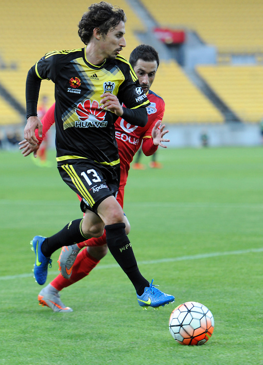 Phoenix's Albert Riera, left, plays in front of Adelaide United's Sergio Cirio in the A-League football match at Westpac Stadium, Wellington, New Zealand, Friday, November 13, 2015. Credit:SNPA / Ross Setford