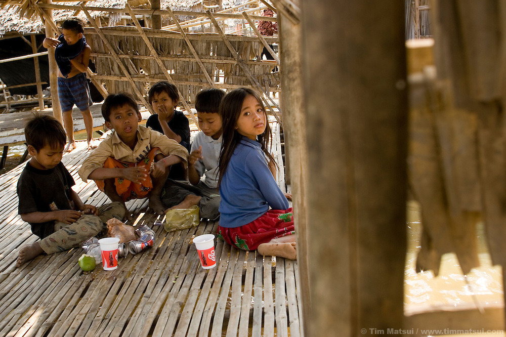 Beggar children play and eat scraps at Tonle Bati, a lake near Phnom Penh, Cambodia.