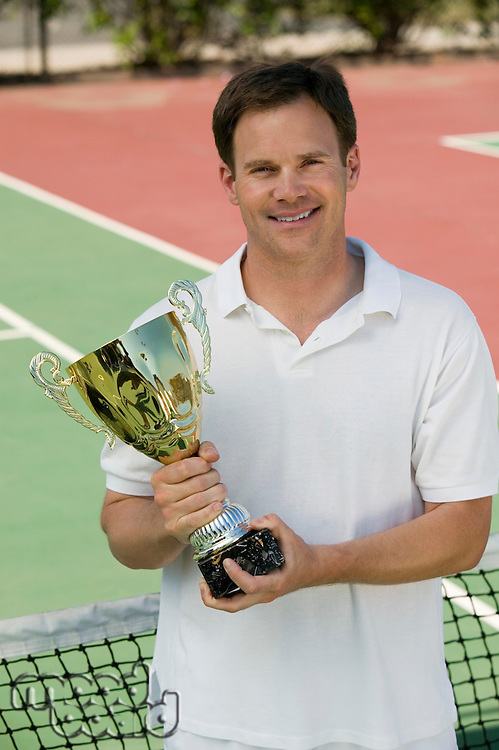 Man Holding Tennis Trophy