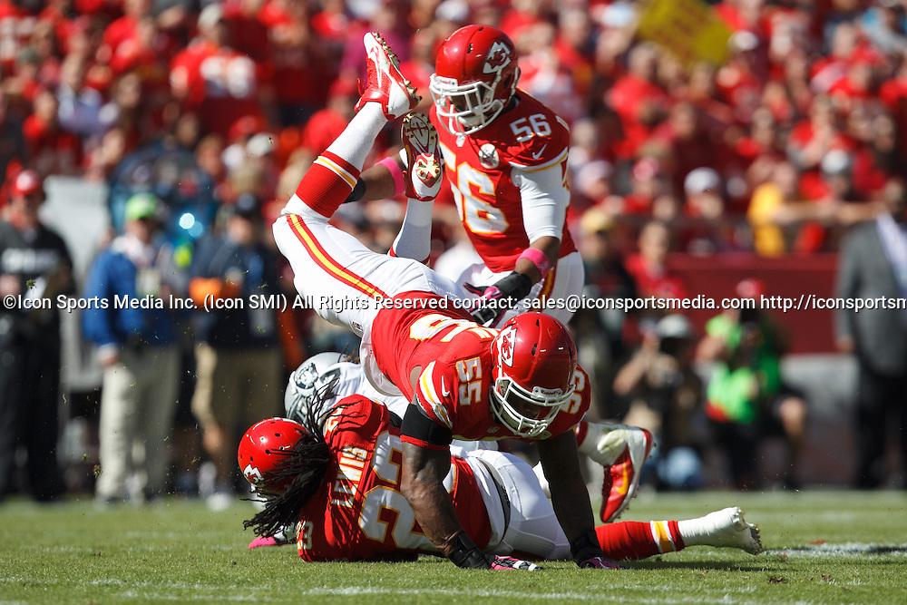 October 13, 2013: Kansas City Chiefs free safety Kendrick Lewis (23) and inside linebacker Akeem Jordan (55) converge on a tackle during the Kansas City Chiefs 24-7 victory over the Oakland Raiders at Arrowhead Stadium in Kansas City, Missouri.