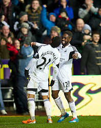 SWANSEA, WALES - Sunday, March 2, 2014: Swansea City's Jonathan De Guzman celebrates scoring the first goal against Crystal Palace with team-mate Nathan Dyer during the Premiership match at the Liberty Stadium. (Pic by David Rawcliffe/Propaganda)