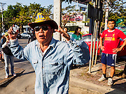 22 DECEMBER 2013 - BANGKOK, THAILAND: An anti-government protestor screams at Thai police blocking the road to the home of Yingluck Shinawatra. Hundreds of thousands of Thais gathered in Bangkok Sunday in a series of protests against the caretaker government of Yingluck Shinawatra. The protests are a continuation of protests that started in early November and have caused the dissolution of the Pheu Thai led government of Yingluck Shinawatra. Protestors congregated at home of Yingluck and launched a series of motorcades that effectively gridlocked the city. Yingluck was not home when protestors picketed her home.     PHOTO BY JACK KURTZ