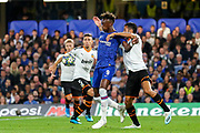 Chelsea forward Tammy Abraham (9) held by Valencia CF defender Ezequiel Garay (24) during the Champions League match between Chelsea and Valencia CF at Stamford Bridge, London, England on 17 September 2019.